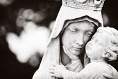 stock photo of monochromatic  - Monochromatic image of the Virgin Mary carrying the baby Jesus - JPG