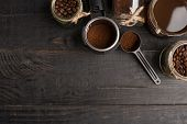 Preparation Of Coffee, Ground Coffee, Coffee Beans, On A Dark Background, Top View With Empty Space  poster