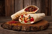 Burrito And Shawarma Wraps With Beef And Pork Vegetables On Wooden Table poster