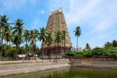Gopura (tower) and temple tank of Lord Bhakthavatsaleswarar Temple. Built by Pallava kings in 6th century. Thirukalukundram (Thirukkazhukundram), near Chengalpet. Tamil Nadu, India