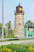 picture of burlington  - Roadisde 1858 limestone lighthouse once used to guide mariners in to Hamilton Harbour from Lake Ontario through the Burlington Canal Canada now decommissioned in favour of electonic unmanned lights - JPG