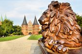 Lion beside Holstein Gate (built in 1478), Lubeck, Germany