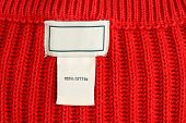Clothing Label Inside Of Red Sweater