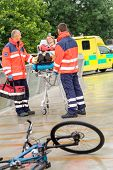 pic of stretcher  - Bike accident paramedics with woman on emergency stretcher ambulance aid - JPG