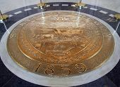 foto of ox wagon  - The state seal of Oregon on the floor of the capital foyer - JPG