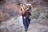 Gorkhas Men Carry Heavy Basket In The Himalaya