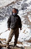 Trekking guide on the pass, Nepal