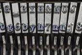 Vintage typewriter typebar hammers extreme macro.