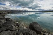Reflections in Canal above Lake Pukaki. New Zealand