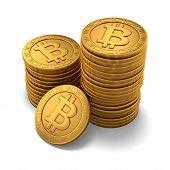 Pequeno grupo de Bitcoins dourado gravado em branco