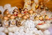 stock photo of little angel  - Little figures of several angels singing for Christmas - JPG
