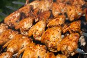 Cooking Delicious Juicy Chicken Wings At Outdoors Grill