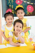 stock photo of kiddie  - Portrait of a group of asian children indoors - JPG