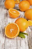 foto of exotic_food  - Fresh oranges on wooden table - JPG