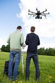 Photography RC multirotor helicopter operated by a photographer and pilot