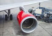 image of rotor plane  - Red Turbine of the airplane under checking - JPG