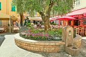 MENTON - JUNE 13: Small square with restaurants and coffee shops in town on Cote d'Azur (aka French