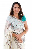 Indian woman smiling. Portrait of mid age beautiful Indian female in traditional saree standing isol