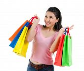 Happy Asian shopping woman smiling holding many shopping bags. Casual Asian shopper girl isolated on white background. Beautiful mixed race Caucasian Southeast Asian woman model.