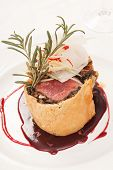 stock photo of beef wellington  - Fillet Wellington with fresh herbs - JPG