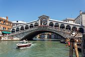 Italy, Venice - July 2012 - A Lot Of Traffic On The Grand Canal Under Ponte Di Rialto On July 16, 20