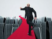 man run on 3d red carpet abstract background