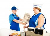Teenage fast food manager makes an adult woman mop up.  white background.