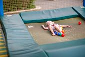 stock photo of bounce house  - Little boy on a children - JPG
