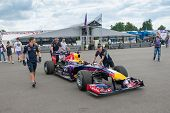 MOSCOW - JUNE 23: Mechanics prepare Formula 1 Red Bull Infiniti racing car for race at World Series by Renault in Moscow Raceway on June 23, 2013 in Moscow