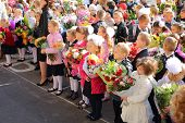 MOSCOW - SEP 1: Children with flowers in front of the School No. 1349 on the first day of school on