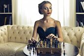 beautiful woman playing chess
