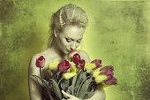 Girl Smelling Tulips In Green Color