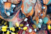 foto of fishnet  - fishing nets with plastic buoys as a background - JPG
