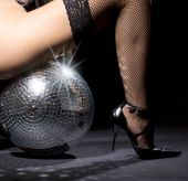 picture of fetish fishnet stockings  - party dancer girl in fishnet stockings with disco ball - JPG
