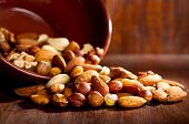 picture of mixed nut  - still life with mix nuts on a wooden table - JPG