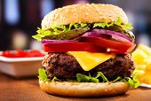 image of hamburger  - hamburger with fries on a wooden table - JPG