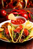 stock photo of nachos  - plate with taco nachos chips and tomato dip - JPG