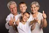 Fun family with thumbs up