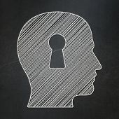 Safety concept: Head With Keyhole on chalkboard background