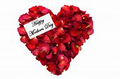 Dried rose petals in a heart shape.