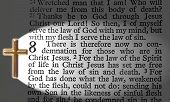stock photo of bible verses  - The bible passage of romans lit up by a cross - JPG