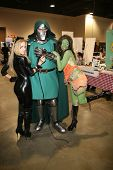 Paula Labaredas and Alicia Arden from CelebrityCosplay.com with Dr. Doom at Long Beach Comic-Con Day