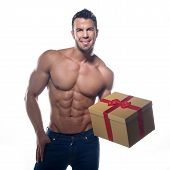 pic of hunk  - Muscular sexy man with a gift on a white background - JPG