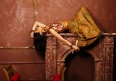 beauty sensual young woman in oriental style in luxury room