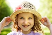 Happy Smiling Little Girl In A Hat