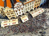 Aerial view of tourists watching Astronomical Clock (Orloj) in the Old Town of Prague.