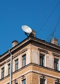 Satellite Dish On Background Of An Old  House