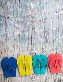 Concept of summer sandals on wood, shot from upper view