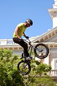 Young Man Practices Bicycle Ramp Jumps At Bmx Competition