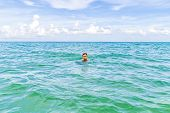 Teenage Boy Enjoys Swimming In The Ocean